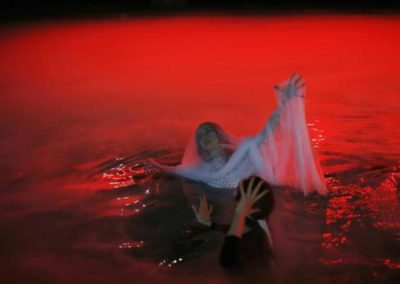 """Smith floats in dry-ice filled swimming pool during rehearsal of Chicago Opera Theater's production of """"Orpheus & Euridice"""" in Chicago"""